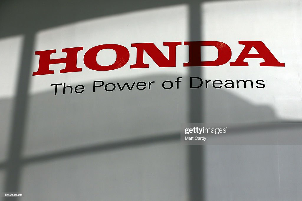 The Honda logo is seen on the wall of a building at the Honda car assembly plant following the announcement that the firm is to axe 800 jobs on January 11, 2013 in Swindon, England. The Japanese car maker, which employs 3500 people and assembles the Civic, Jazz and CR-V models at the Wiltshire plant, blames weak demand in the Eurozone for the cuts.