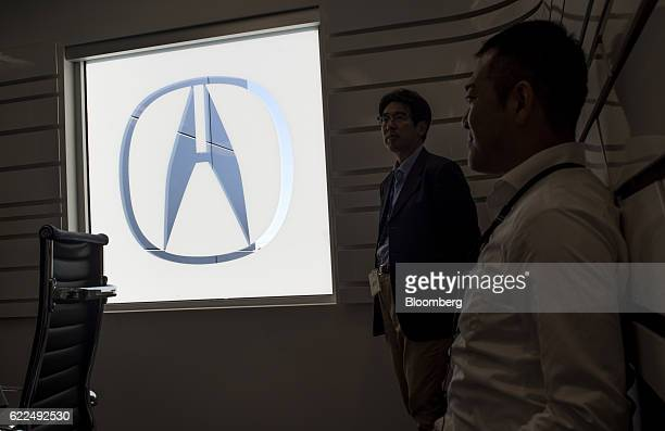 The Honda Motor Co Acura logo hangs on display in the conference room of the Honda Performance Manufacturing Center in Marysville Ohio US on Thursday...