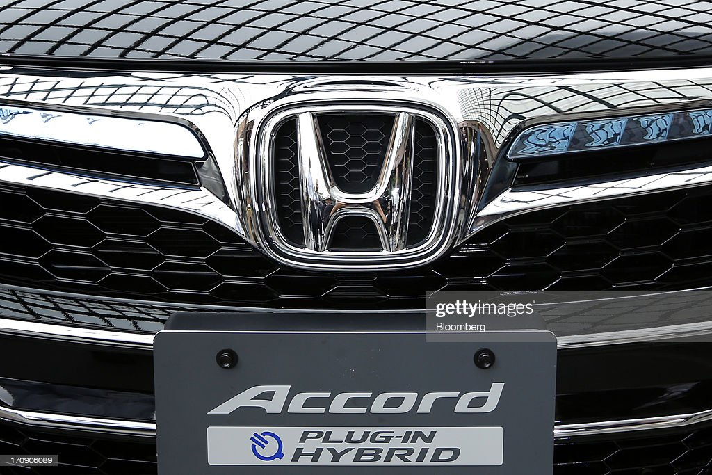 The Honda Motor Co. emblem is displayed on the front of the company's Accord plug-in hybrid sedan at its unveiling in Tokyo, Japan, on Thursday, June 20, 2013. Honda, Japan's third-largest carmaker, unveiled a hybrid sedan at a 20 percent higher price than Toyota Motor Corp.'s gasoline-electric Camry, betting drivers will pay extra for fuel economy. Photographer: Kiyoshi Ota/Bloomberg via Getty Images