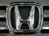 The Honda Motor Co logo is displayed on the company's N Box minicar at the company's headquarters in Tokyo Japan on Friday Sept 21 2012 Honda Japan's...
