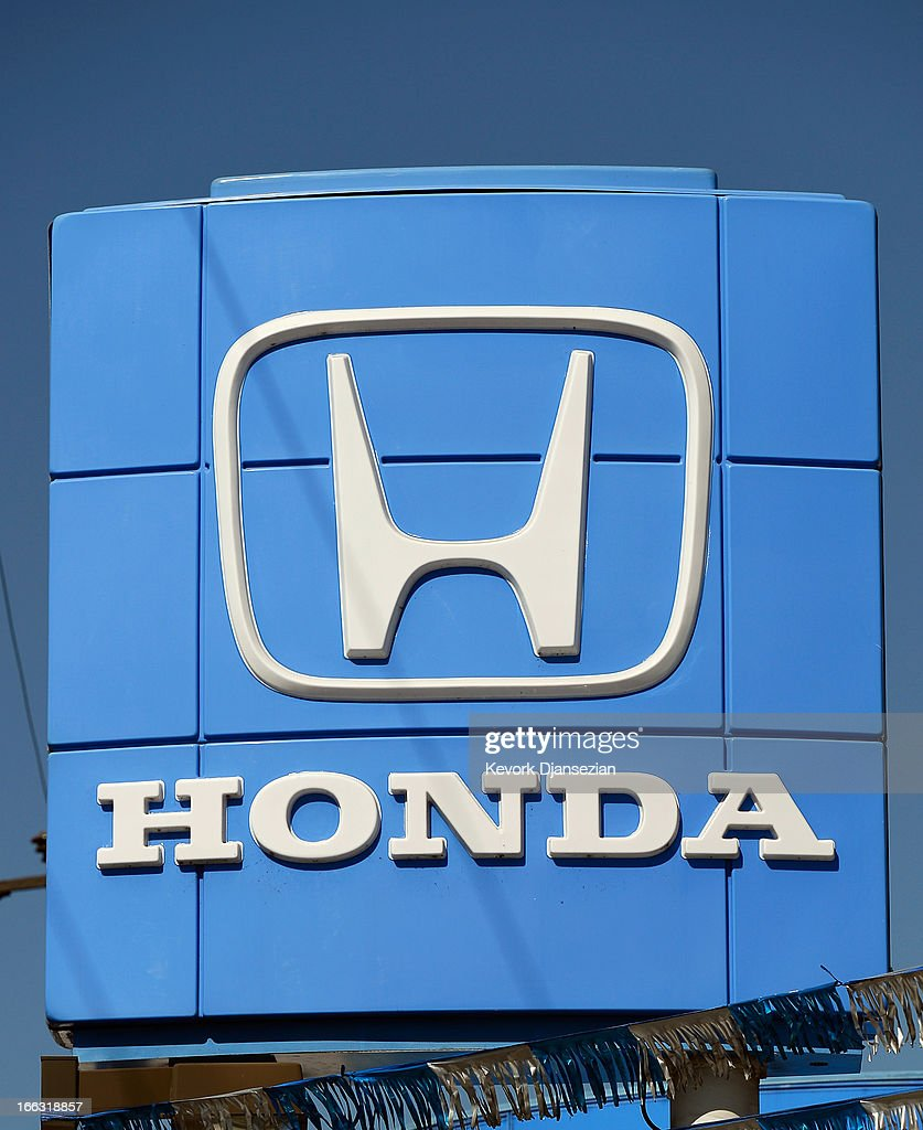The Honda Motor Company logo is displayed on a dealership on April 11 2013 in Los Angeles California Four automakers Honda Toyota Nissan and Mazda...