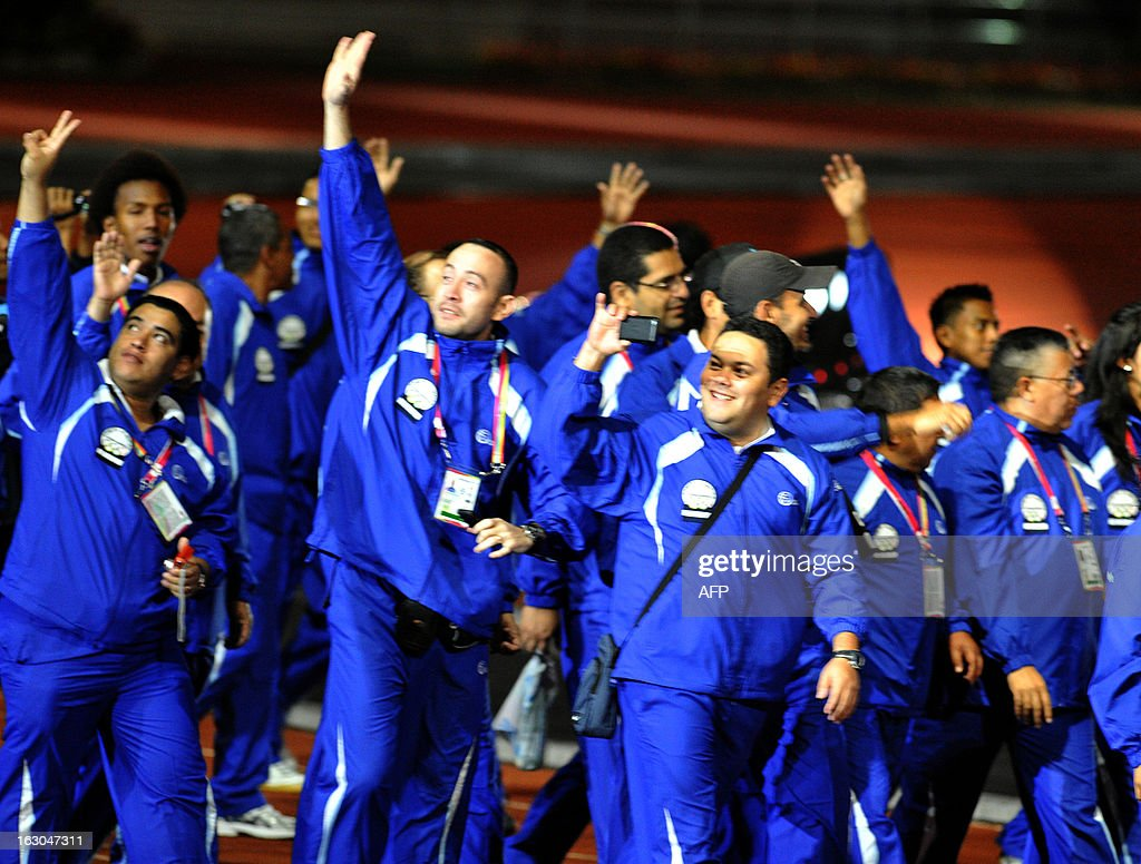 The Honduran delegation waves as they participate in the opening ceremony for the 2013 Central American Games in San Jose on March 3, 2013. The 10th Central American Games are taking place from March 3 to 17 in Costa Rica. AFP PHOTO / Ezequiel BECERRA