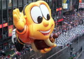 The Honey Nut Cheerios Bee balloon moves through Times Square in New York during the Macy's Thanksgiving Day Parade 25 November 1999 The Honey Nut...