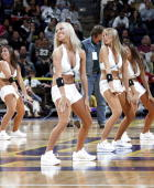 The Honeybees Dance Team entertain the crowd during a preseason game between the New Orleans/Oklahoma City Hornets and the Miami Heat on October 25...