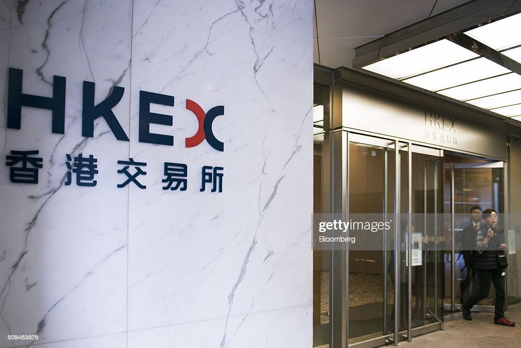 The Hong Kong Exchanges and Clearing Ltd. (HKEx) logo is displayed at the entrance of the bourse's building in Hong Kong, China, on Thursday, Feb. 11, 2016. Hong Kong stocks headed for their worst start to a lunar new year since 1994 as a global equity rout deepened amid concern over the strength of the world economy. Photographer: Xaume Olleros/Bloomberg via Getty Images