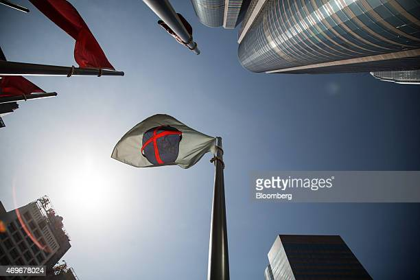 The Hong Kong Exchanges Clearing Ltd flag flies outside Exchange Square in Hong Kong China on Tuesday April 14 2015 Chinese stocks trading in Hong...