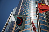 The Hong Kong Exchanges Clearing Ltd flag left flies outside Exchange Square in Hong Kong China on Tuesday April 14 2015 Chinese stocks trading in...