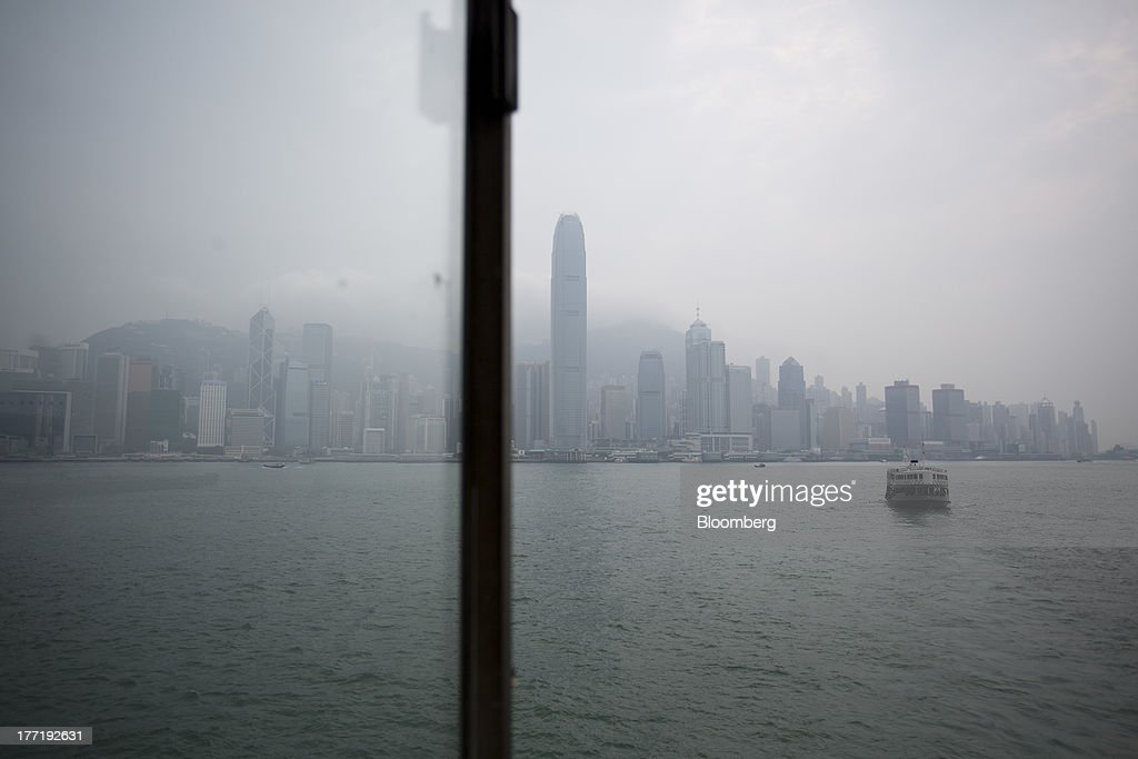 The Hong Kong island skyline stands behind a Star Ferry vessel sailing in the harbor of Hong Kong, China, on Thursday, Aug. 22, 2013. Hong Kongs air pollution index reached very high level today as a tropical storm that passed through Taiwan trapped pollutants and blanketed the city in haze, triggering a government health warning. Photographer: Jerome Favre/Bloomberg via Getty Images