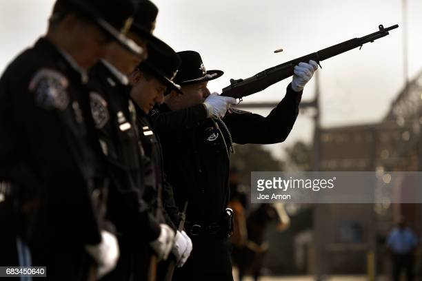 The Honor Guard fired one round for each officer being honored during the Denver Sheriff's Department memorial ceremony for DSD officers who have...