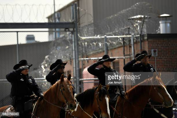 The Honor Guard Mounted Posse salute the officers being honored during the Denver Sheriff's Department memorial ceremony for DSD officers who have...