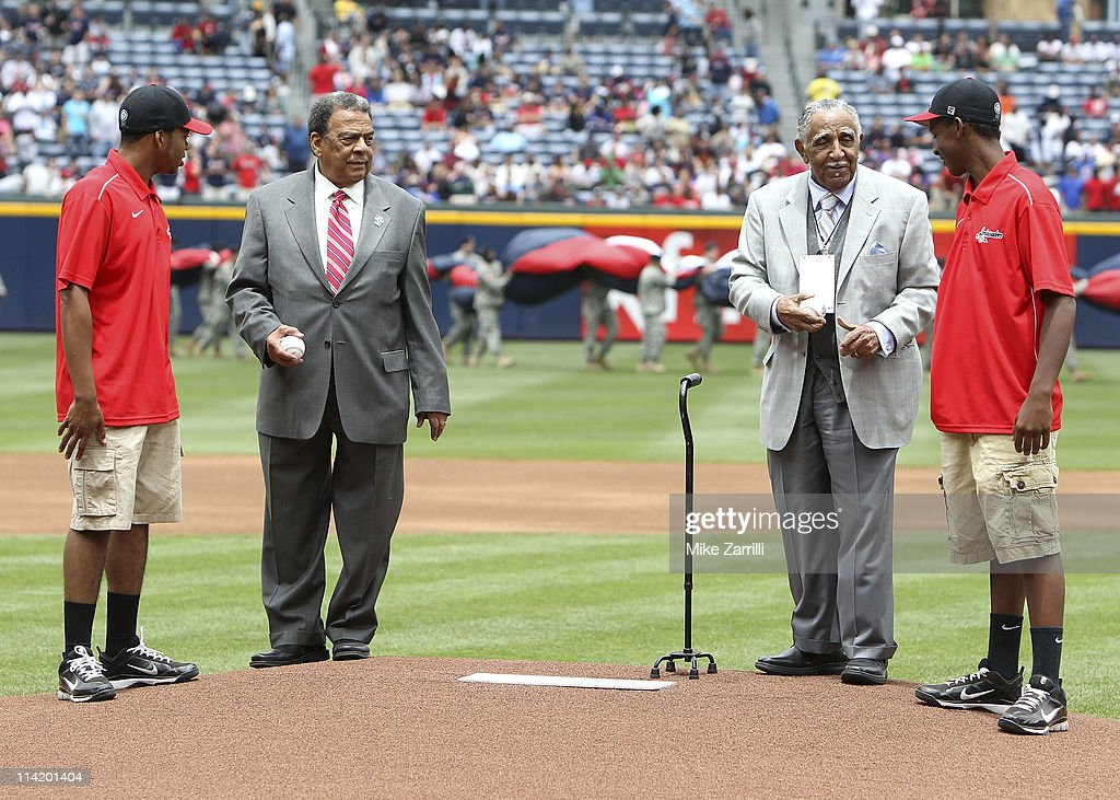 The Honorable Andrew Young, former US Ambassador to the United Nations (2nd L) and Reverend Joseph Lowery (2nd R) talk with 2 young gentlemen before the ceremonial first pitch before the MLB Civil Rights Game between the Philadelphia Phillies and the Atlanta Braves on Sunday, May 15, 2011 at Turner Field in Atlanta, Georgia.