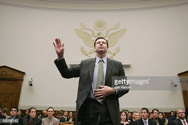 The Honorable James Comey Deputy Attorney General US Department of Justice is sworn in before delivering testimony during the House Judiciary...