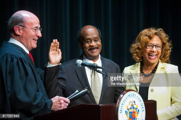 The Honorable Roger Titus US District Court for the District of Maryland left laughs along with Montgomery County Executive Isiah Leggett and his...