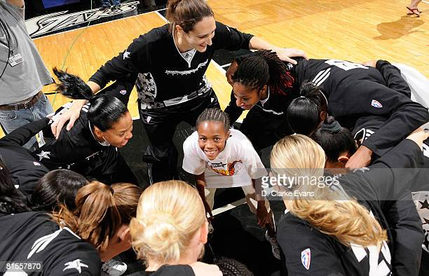 The honorary ball girl warms up with the San Antonio Silver Stars before the game against the Seattle Storm on June 13 2008 at the ATT Center in San...