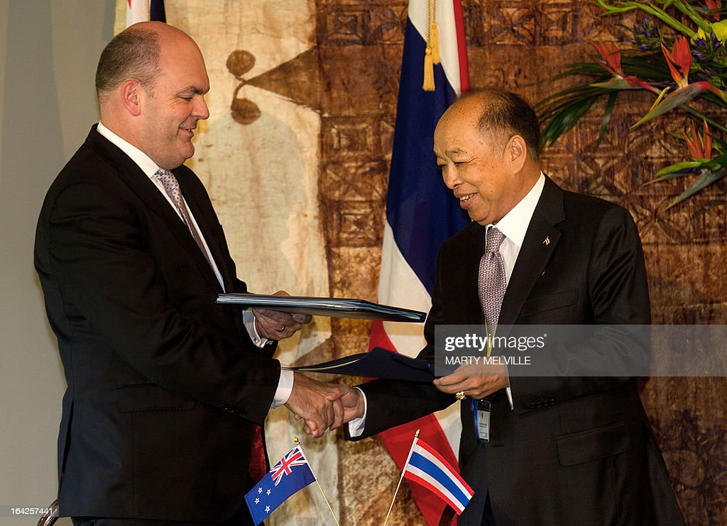 The Honourable Steven Joyce (L), Minister for Economic Development and Mr Surapong Tovichakchaikul the Thai Foreign Minister shake hands after the signing of the New Zealand Education and Science Arrangements during a meeting at Government House in Auckland on March 22, 2013, during a visit by Thailand's Prime Minister Yingluck Shinawatra (not pictured). Yingluck is on a three-day visit to New Zealand.
