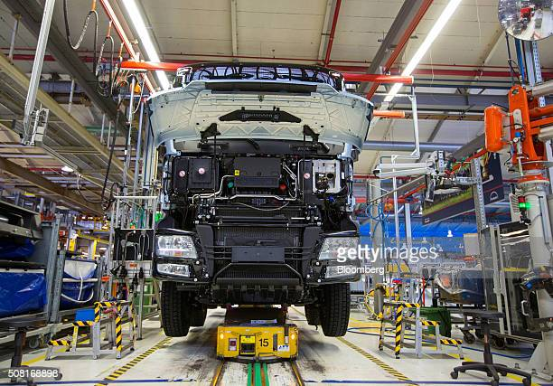 The hood of a MAN TGs heavy goods truck sits open on the assembly line inside the MAN SE factory at the headquarters of Volkswagen AG's...