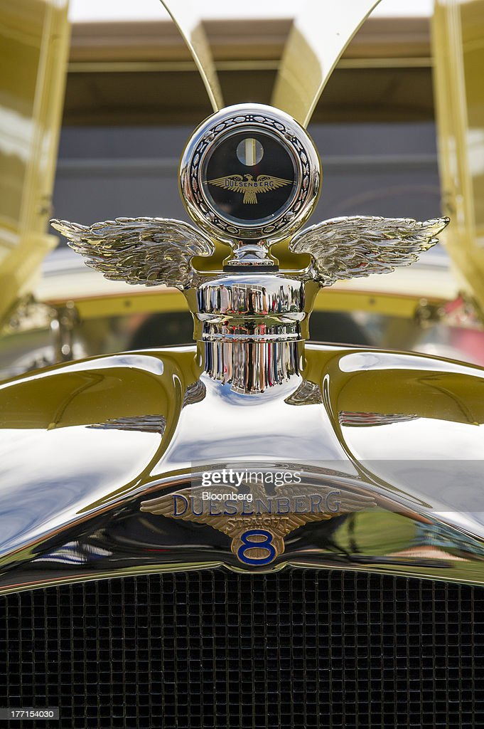 The hood ornament of a 1931 Duesenberg J Rollston Victoria is displayed during the 2013 Pebble Beach Concours d' Elegance in Pebble Beach, California, U.S., on Sunday, Aug. 18, 2013. The annual event in its 63rd year raised $1.277 million U.S. dollars for charity and showcased 248 cars, 48 from abroad. Photographer: David Paul Morris/Bloomberg via Getty Images