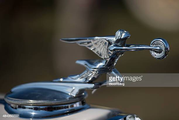 The hood ornament of a 1932 Packard Motor Car Co 904 Deluxe Eight Dietrich Stationary Coupe vehicle is seen during the 2015 Pebble Beach Concours...