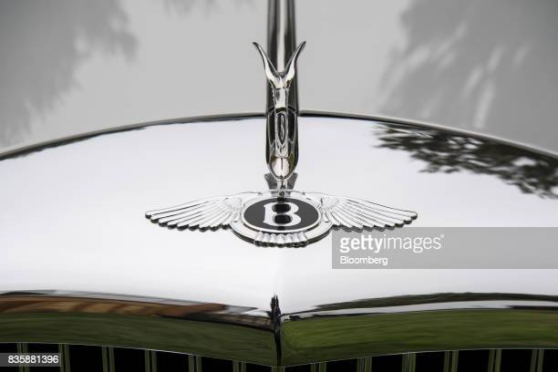 The hood ornament of a restored 1958 Bentley S1 Continental Park Ward Drophead Coup that was found in the garage of Saddam Hussein after he was...