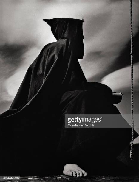 The hooded man of Legnano This picture is taken from the monography 'Mario De Biasi Il mio sogno Š qui' curated by Enrica Vigan• published in 2016 by...