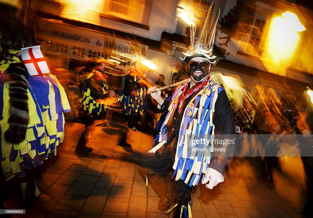The Hook Eagle Morris Men dance outside the Waggon and Horses pub during the annual Wassail night in Hartley Wintney, 40 miles (64 Kilometers) west of London, on January 4, 2013. The event, held near to twelfth night, celebrates both the passing of Christmas and the future good health of the fruit trees. Traditionally the custom involved the local farm workers visiting the orchard after dark with shotguns, horns, food and a large pail of cider. They would make a loud noise to raise the Sleeping Tree Spirit and to scare off demons. Cider would be poured over the roots and pieces of toast placed in the branches as a gift to the spirit of the tree. The wassail song is sung as a blessing or charm to bring fruitfulness or even in admonishment not to fail in the upcoming year. AFP PHOTO / ADRIAN DENNIS