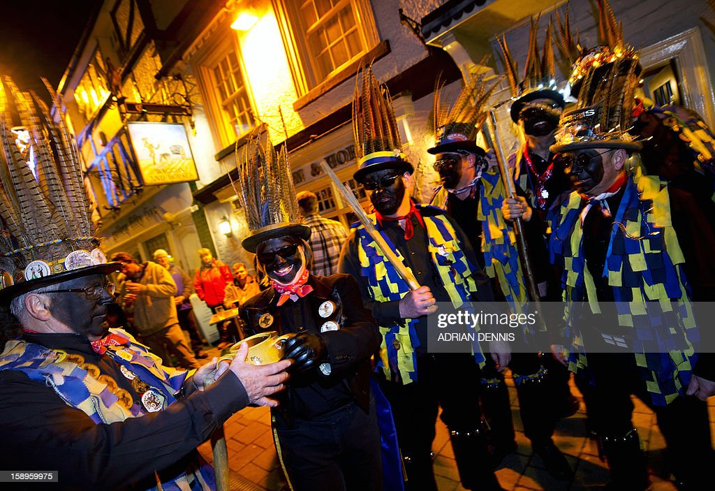 The Hook Eagle Morris Men pass the wassail cup to drink a toast during the annual Wassail night in Hartley Wintney, 40 miles (64 Kilometers) west of London, on January 4, 2013. The event, held near to twelfth night, celebrates both the passing of Christmas and the future good health of the fruit trees. Traditionally the custom involved the local farm workers visiting the orchard after dark with shotguns, horns, food and a large pail of cider. They would make a loud noise to raise the Sleeping Tree Spirit and to scare off demons. Cider would be poured over the roots and pieces of toast placed in the branches as a gift to the spirit of the tree. The wassail song is sung as a blessing or charm to bring fruitfulness or even in admonishment not to fail in the upcoming year.