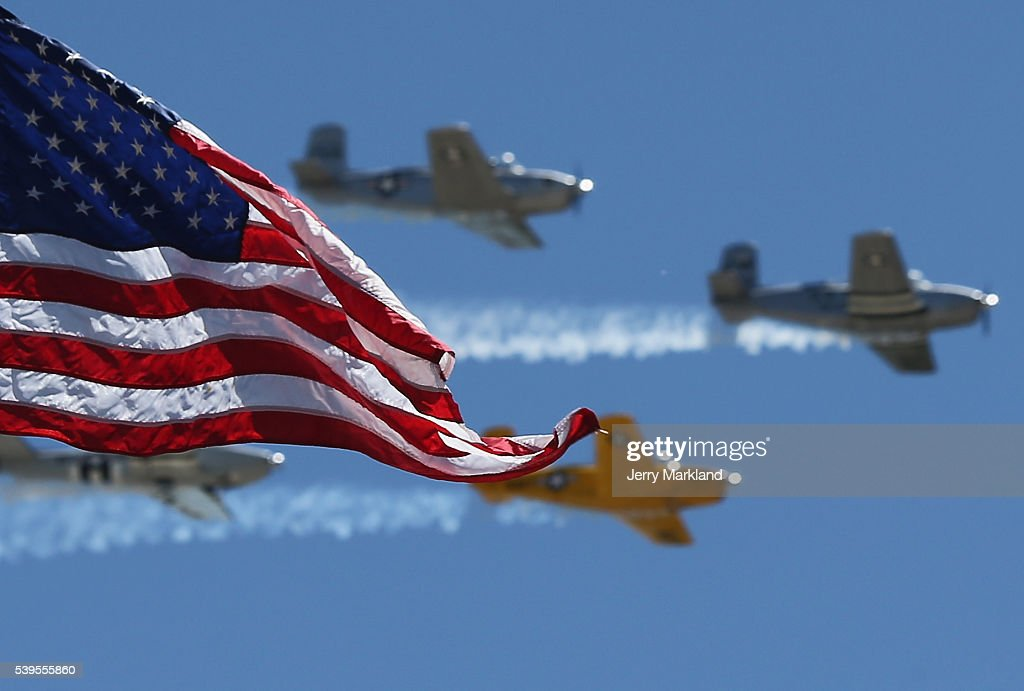 The Hooligan Flight Team does a flyover for the NASCAR Sprint Cup Series FireKeepers Casino 400 at Michigan International Speedway on June 12 2016 in...