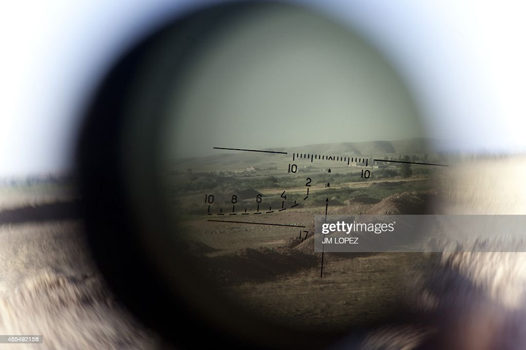 The horizon is seen through a telescopic rifle belonging to a Kurdish Peshmerga sniper on the front line in the Gwer district, 40 kilometres south of Arbil, the capital of the Kurdish autonomous region in northern Iraq, on September 15, 2014. Participants at an international conference in Paris pledged to support Iraq by all possible means to fight jihadists, including providing military support.