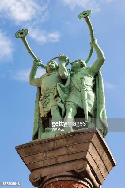 The Horn Blowers statue also Lur and Lure blowers Lurblaeserne Radhuspladsen Copenhagen Denmark