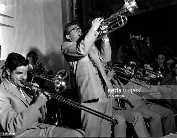 The horn section of Ronnie Scott's Big Band perfomring live onstage Ronnie Scott not in image 1956