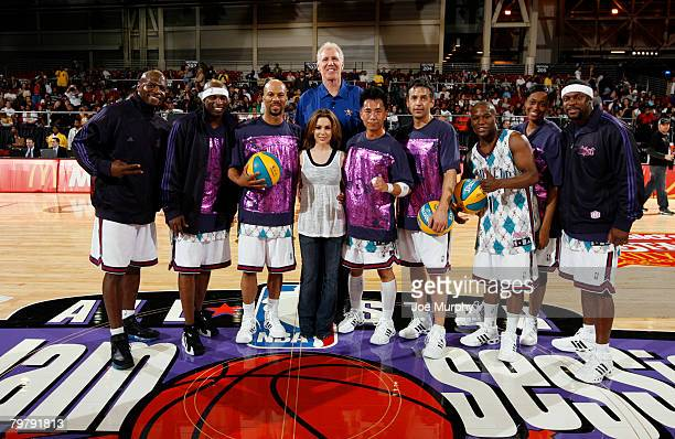 The Hornets team poses with their coach the actress Alyssa Milano and general manager former NBA great Bill Walton during the McDonald's NBA AllStar...