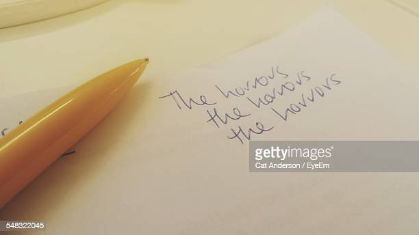 The Horrors Text Written On Paper With Pen On It