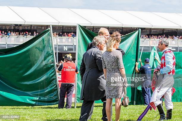 The horse Red Cadeaux which broke down near the finish line has a green screen placed around him as the horses jockey Gerald Mosse walks past during...