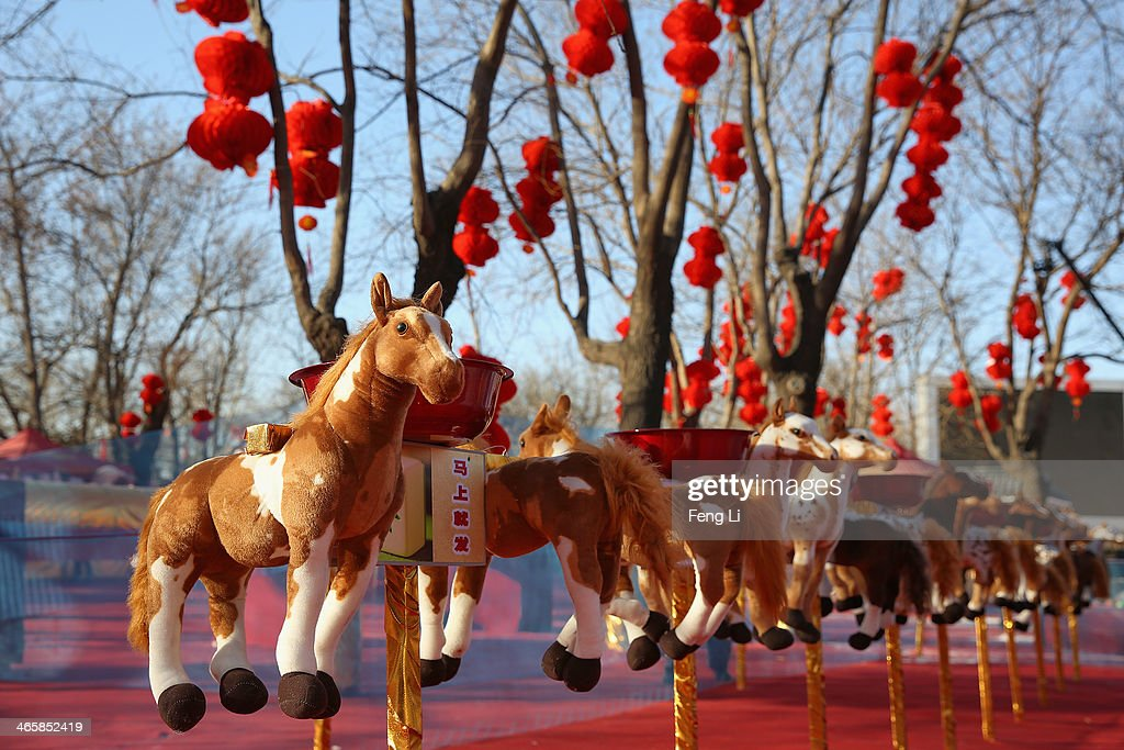 The horse toys are seen at a game area of the Spring Festival Temple Fair for celebrating Chinese Lunar New Year of Horse at the Temple of Earth park on January 30, 2014 in Beijing, China. The Chinese Lunar New Year of Horse also known as the Spring Festival, which is based on the Lunisolar Chinese calendar, is celebrated from the first day of the first month of the lunar year and ends with Lantern Festival on the Fifteenth day.