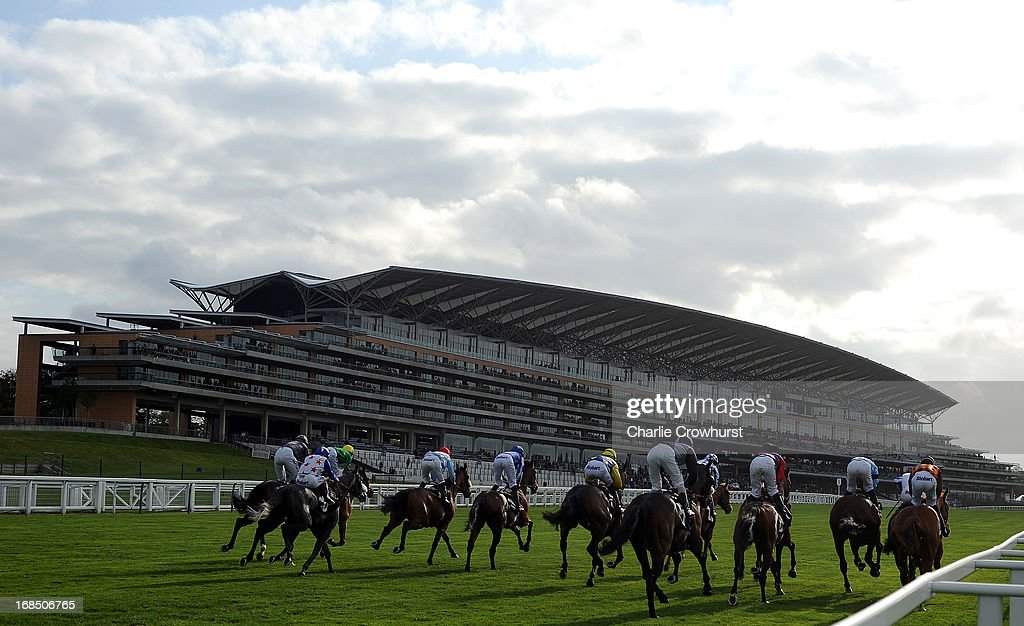 The Horses and Jockeys head past the grandstand during the Two Circles Handicap Stakes at Ascot racecourse on May 10, 2013 in Ascot, England.