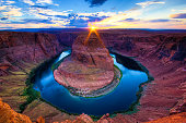 Sunset at The Horseshoe Bend, Page - Arizona. Amazing Grand Canyon of the Colorado River. Sunburst.