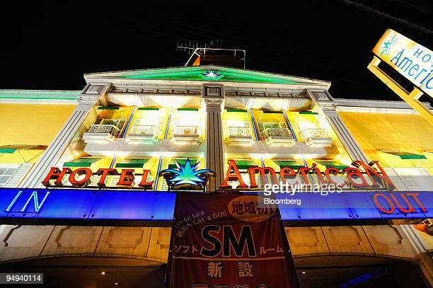 The Hotel American love hotel is lit up at night on the outskirts of Tokyo Japan on Monday April 20 2009 While Japanese companies have announced more...
