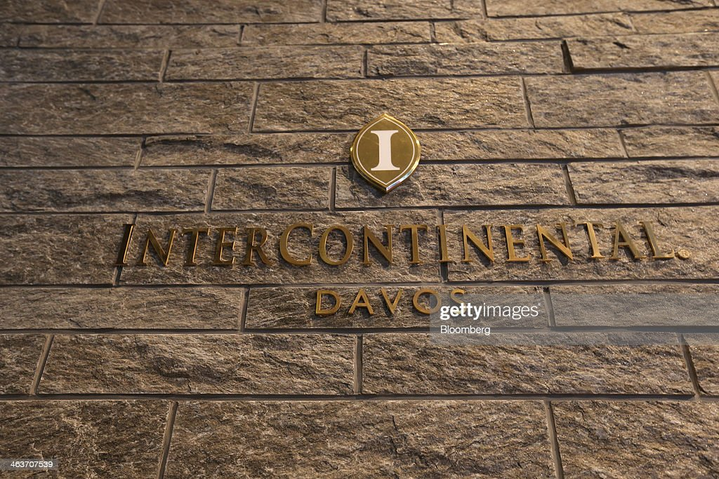 The hotel sign for the InterContinental hotel Davos, operated by InterContinental Hotels Group Plc (IHG) is seen at the hotel entrance in Davos, Switzerland, on Saturday, Jan. 18, 2014. Next week the business elite will gather in the Swiss Alps for the 44th annual meeting of the World Economic Forum (WEF) in Davos for the five day event which runs from Jan. 22-25. Photographer: Simon Dawson/Bloomberg via Getty Images