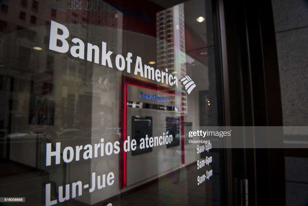 The hours of operation are displayed on the door of a Bank of America Corp. branch in Chicago, Illinois, U.S., on Sunday, July 9, 2017. Bank Of America Corp. is scheduled to release earnings figures on July 18. Photographer: Christopher Dilts/Bloomberg via Getty Images