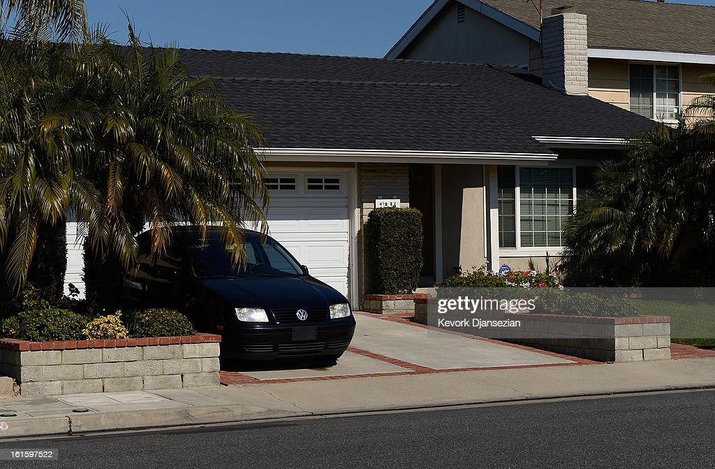 The house of Christopher Dorner's mother is seen as the manhunt continues for the murder suspect on February 12, 2013 in La Palma, California. Dorner, a former Los Angeles Police Department officer and Navy Reserve veteran, is wanted in connection with the deaths of an Irvine couple and a Riverside police officer. LAPD removed evidence during the search of the house owned 62-year-old Nancy Dormer. The manhunt for Christopher Dorner has gone international as police raided a Mexican hotel overnight in Tijuana, Mexico.