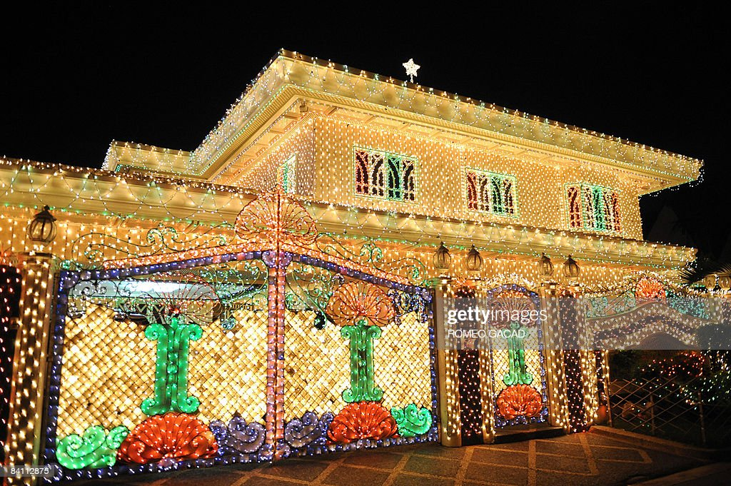 The house of Filipino businessman Domingo Dalisay is wrapped in Christmas lights in Mandaluyong city, suburban Manila on December 22, 2008.The Dalisay family have started the tradition of decorating their house with Christmas lights in 1996 where visitors flock to admire and enjoy the colorful sight as Filipinos celebrate Christmas with their families.