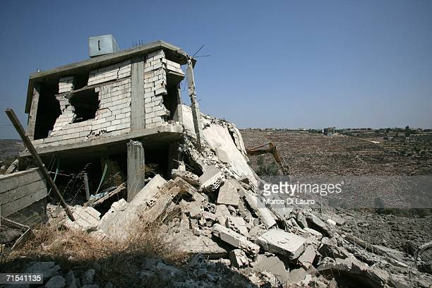 The house that was hit by an Israeli strike from which over 50 bodies were extracted is seen July 30 2006 in Qana Southern Lebanon Approximately 56...