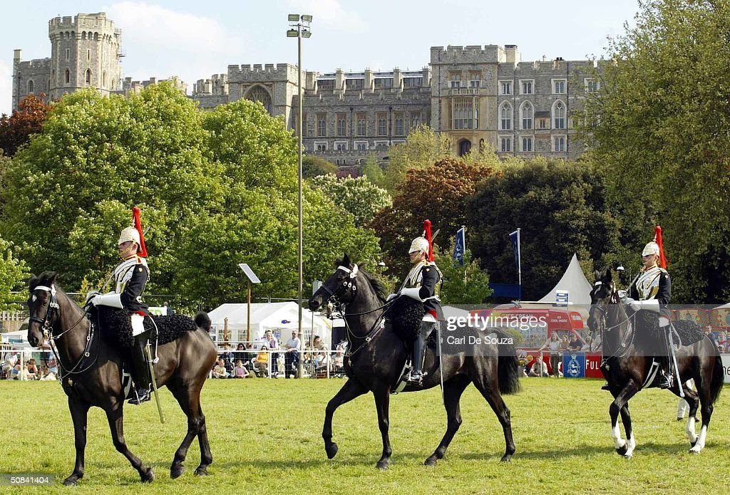 The Household Cavalry parade in front of Windsor Castle on the third day of the Royal Windsor Horse Show at Home Park May 15, 2004 in Windsor, England.