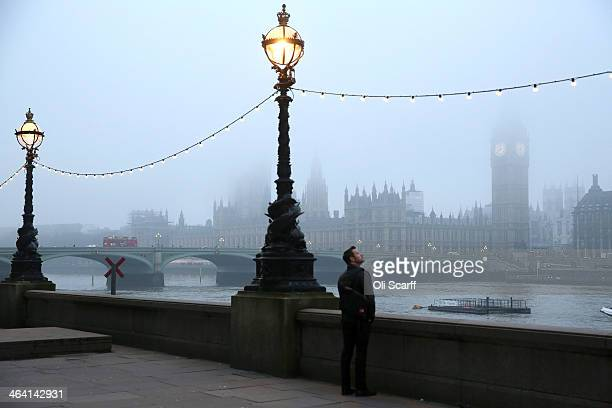 The Houses of Parliament and the river Thames are shrouded in early morning fog on January 21 2014 in London England