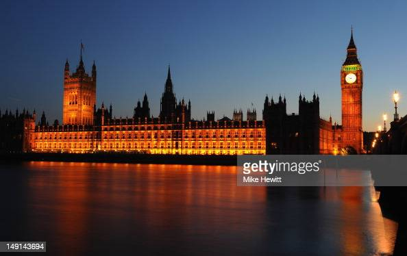 The Houses of Parliament are lit up at sunset on July 23 2012 in London England
