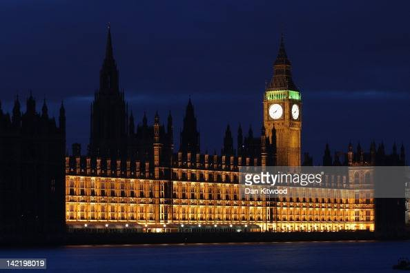 The Houses of Parliament in central London before the lights are turned off to mark 'Earth Hour' on March 31 2012 in London England According to...
