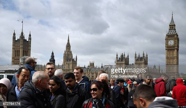 The Houses of Parliament including Big Ben and The Elizabeth Tower loom large above the heads of tourists as they cross the Westminster Bridge May 9...