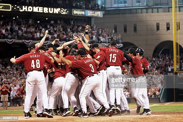 The Houston Astros celebrate after Chris Burke hit a solo home run to defeat the Atlanta Braves in Game Four of the 2005 National League Division...