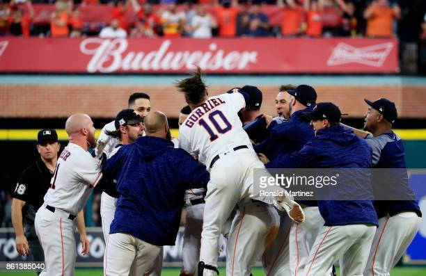 The Houston Astros celebrate their 2 to 1 win over the New York Yankees during game two of the American League Championship Series at Minute Maid...