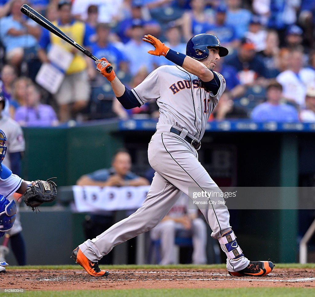 The Houston Astros' Jason Castro follows through on an RBI single in the first inning against the Kansas City Royals on Friday, June 24, 2016, at Kauffman Stadium in Kansas City, Mo.